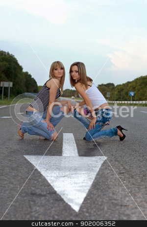Two pretty girls stock photo, Two pretty girls sitting on a road  by Sergii Sukhorukov