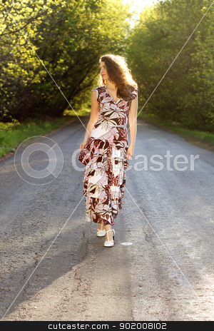 Attractive young woman stock photo, Attractive young woman standing on the road by Sergii Sukhorukov