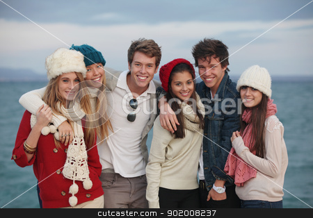 group teens stock photo, happy group of winter autumn teens by mandygodbehear