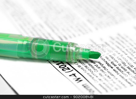 Green marker on W4 form stock photo, Close up shot of a green marker on W4 tax form by Sreedhar Yedlapati
