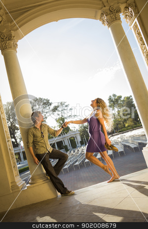 Attractive Loving Couple Portrait in the Outdoor Amphitheater stock photo, Attractive Playful Loving Couple Portrait in the Outdoor Amphitheater. by Andy Dean