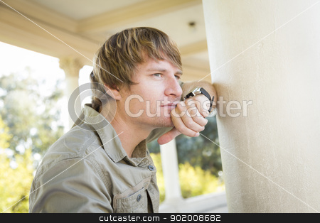 Handsome Thinking Young Man Outside stock photo, Handsome Thinking Young Adult Man Portrait Outside. by Andy Dean