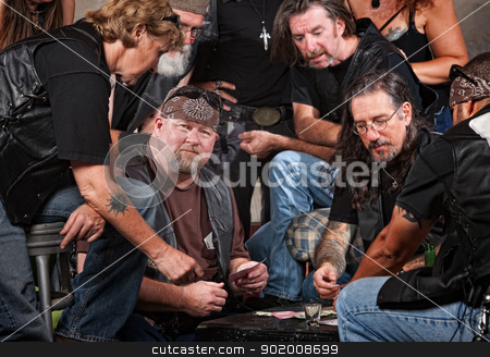 Gang Members Playing Cards stock photo, Serious gang members playing cards and drinking by Scott Griessel