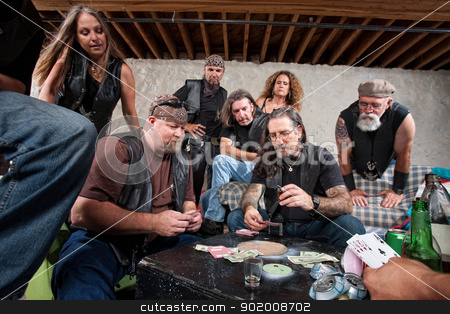 Tough Gang Playing Cards stock photo, Tough group of criminals playing cards and drinking by Scott Griessel