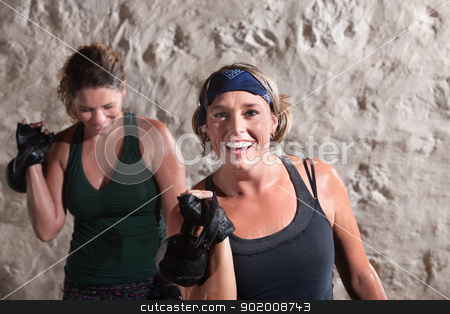 Smiling Women Working Out stock photo, Smiling woman with workout partner lifting weights by Scott Griessel