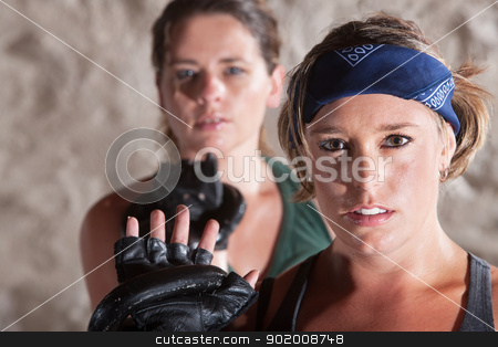 Sexy Females Holding Weights stock photo, Sexy duo of women holding kettle bell weights by Scott Griessel