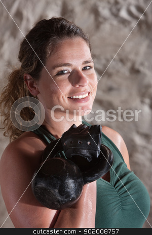 Pretty Lady in Boot Camp Workout stock photo, Pretty woman smiling during boot camp workout by Scott Griessel