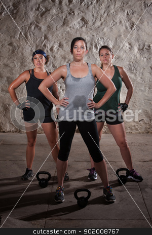 Ladies Finishing Boot Camp Workout stock photo, Strong trio of European women resting during boot camp workout by Scott Griessel