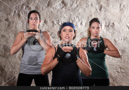 Ladies Lifting Kettlebells in Boot Camp Style Workout stock photo, Serious group of three ladies lifting kettlebell weights by Scott Griessel