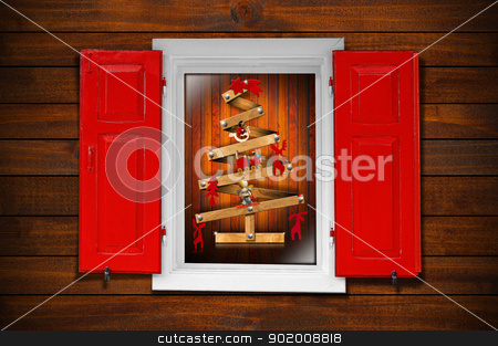 Window and Christmas Tree stock photo, Christmas tree seen through a wooden window with red shutters  by catalby