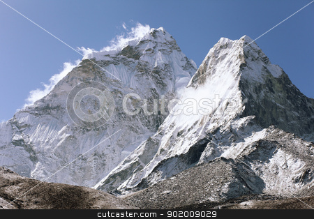 snowy mountains stock photo, High mountains in white cloud. Nepal. Everest by Sergey Nivens
