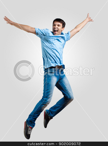 Young man dancing and jumping stock photo, Modern slim hip-hop style man jumping dancing on a grey background by Sergey Nivens