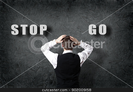 Businessman making a choice stock photo, Senior businessman thinking and making choice while looking up by Sergey Nivens