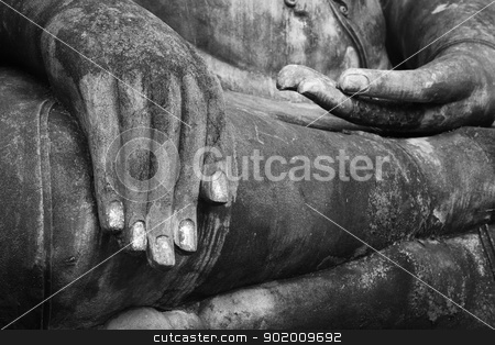 Hand of an ancient Buddha image (black and white) stock photo, Hand of an ancient Buddha image at Sukhothai historical park, Thailand (black and white) by pattarastock