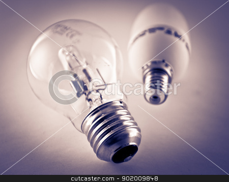 Light bulbs stock photo, Two low energy light bulbs by Tommy Alsn