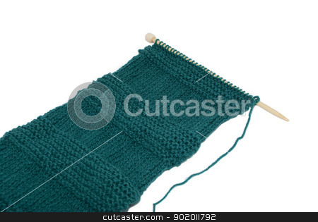 Unfinished scarf on knitting needle stock photo, Unfinished scarf on knitting needle in stocking and garter stitch by Sarah Marchant