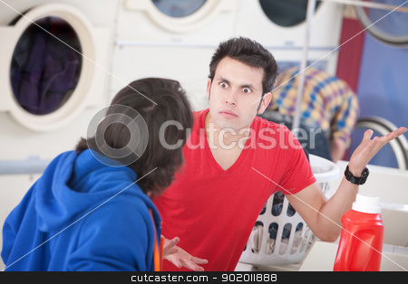 Laundromat Argument stock photo, Two young men argue in the laundromat by Scott Griessel