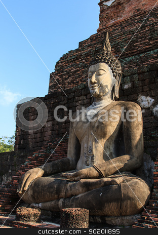 An ancient Buddha image stock photo, An ancient Buddha image at Sukhothai historical park, Thailand by Pugping