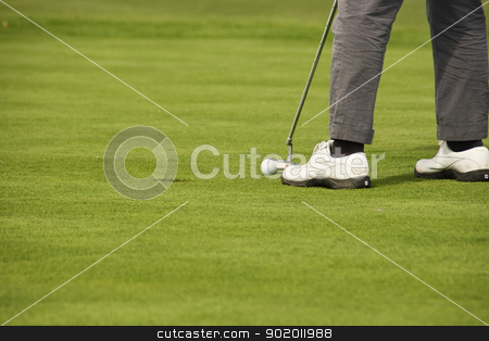 golf stock photo, The feet of a golfer on the verge of throwing by Raquel Vidal Bielsa
