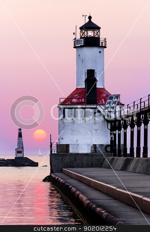 Michigan City Lighthouse with Setting Sun stock photo, The sun sets on the horizon with over Lake Michigan with the Michigan City East Pierhead Lighthouse, Indiana, USA by Kenneth Keifer