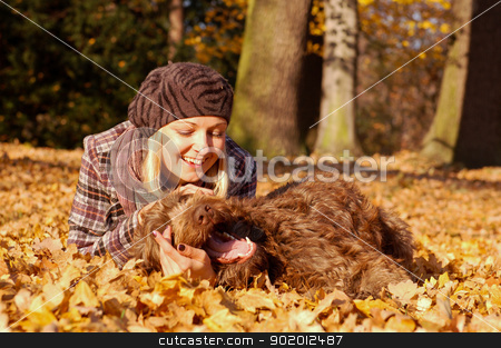 Young woman enjoying autumn stock photo, Young woman enjoying sunny day in autumn in the park by Kamila Starzycka