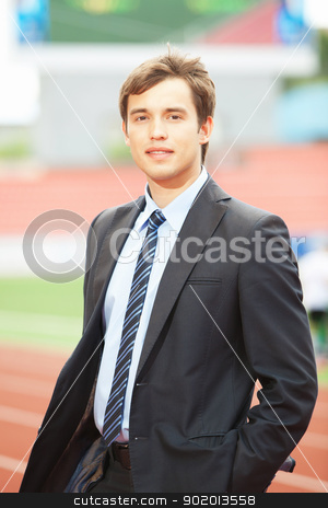 Portrait of a businessman, Outdoor stock photo, Satisfied smiling businessman standing in the summer outdoors. by Sergey Nivens