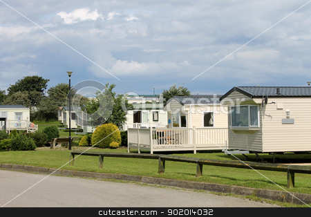Scenic view of caravan trailer park stock photo, Scenic view of caravan trailer park with road in foreground.  by Martin Crowdy