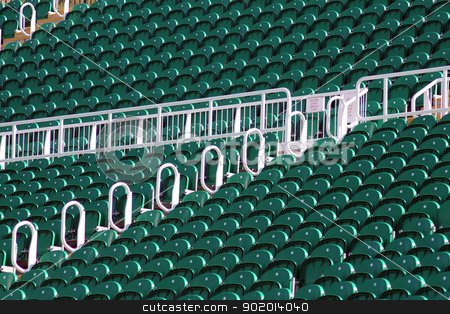 Terrace seats in outdoor stadium stock photo, Terrace seating in outdoor stadium or arena with green theme. by Martin Crowdy