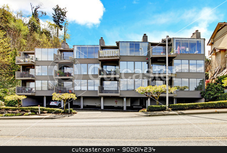 Apartment building with walkway with brenches. stock photo, Apartment building with walkway with brenches in Tacoma, WA. by iriana88w