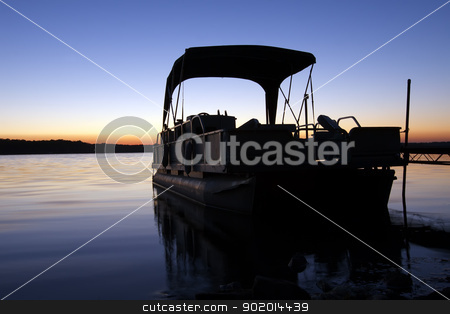 Boat at Sunrise stock photo, A boat silhouetted in the sunrise by Delmas Lehman