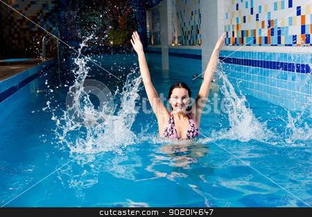 Attractive girl in swimming pool stock photo, Young beautiful woman relaxing in swimming pool by Aikon