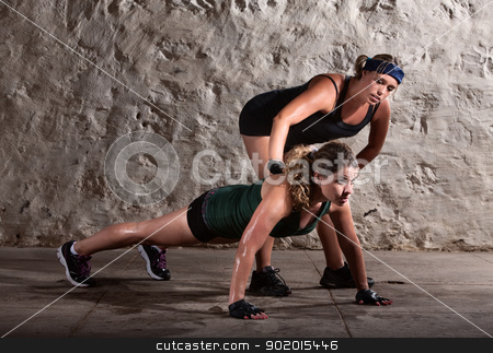 Boot Camp Trainer with Woman stock photo, Bootcamp workout coach helps woman with push ups by Scott Griessel