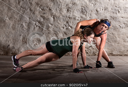 Trainer Helping with Push Ups stock photo, Physical fitness trainer with woman doing right angle pushups by Scott Griessel