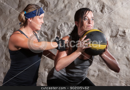 Boot Camp Workout Training with Medicine Ball stock photo, Serious boot camp workout coach with athlete and medicine ball by Scott Griessel