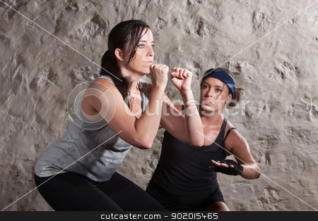 Lady and Trainer Sweating During Boot Camp Style Workout stock photo, Caucasian athlete sweating with trainer in boot camp training workout by Scott Griessel