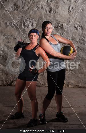 Boot Camp Training Ladies Posing stock photo, Two sweating young women posing with workout equipment by Scott Griessel