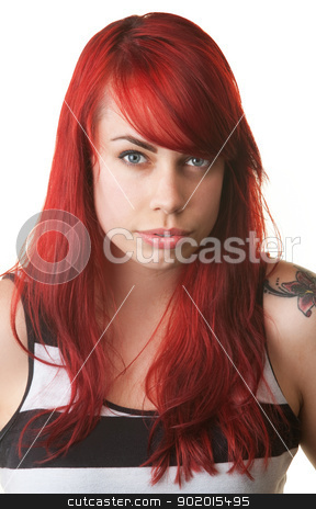 Cynical Lady in Striped Shirt and Red Hair stock photo, Doubtful young woman in red hair and striped shirt by Scott Griessel