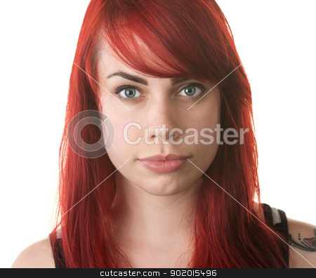Serious Red Haired Woman Staring stock photo, Serious young red haired female staring ahead by Scott Griessel