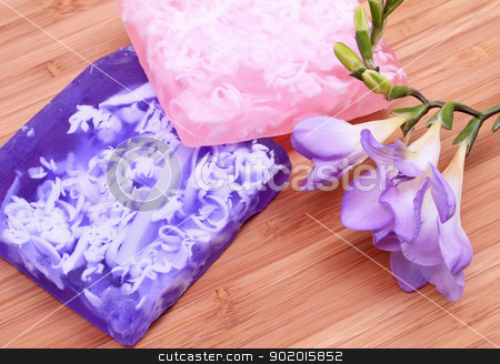 Lilac and pink soap on wooden background in a spa composition  stock photo, Lilac and pink soap with flower on wooden background in a spa composition  by Morozova Oxana
