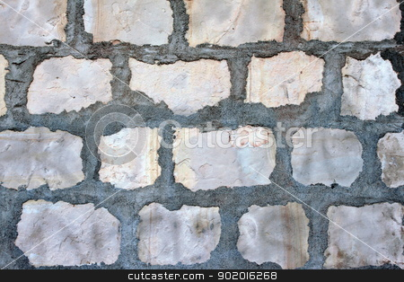 Rock wall stock photo, Gray rock wall at the Santa Barbara Mission. by Henrik Lehnerer