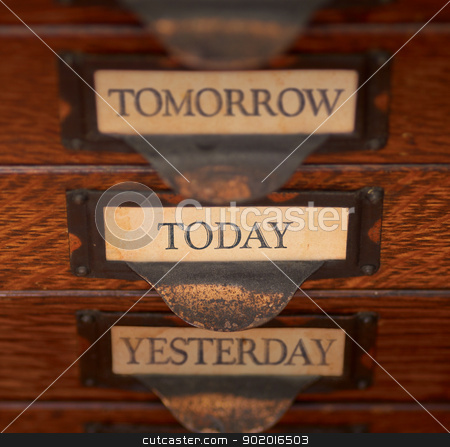 Focus On Today stock photo, Stack of three old, oak flat file drawers with