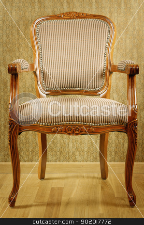 Armchair stock photo, Single Old Antique Armchair Near The Wall by Sergej Razvodovskij