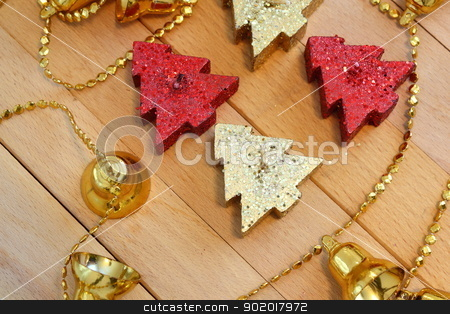 christmas candles stock photo, red and gold christmas tree shaped candles by coroiu octavian