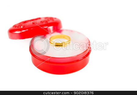 Gold ring on red box stock photo, Gold ring on red box on white background isolated by moggara12