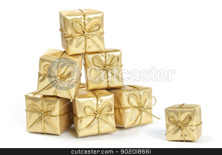 Gold Christmas presents stock photo, Stack of gold Christmas presents with gold ribbons on a white background by Mornay Van Vuuren