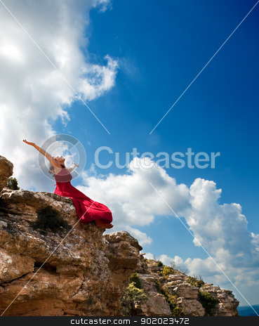Girl with open arms stock photo, Girl with open arms to the blue sky by carloscastilla