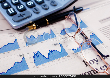 Business and financial background stock photo, Business background with graphics,glasses,pen and calculator by carloscastilla