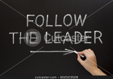 Follow The Leader on Blackboard stock photo, Hand showing Follow The Leader written with white chalk on a blackboard by Ivelin Radkov