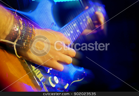  guitar player stock photo, First plane of guitar player in live by carloscastilla