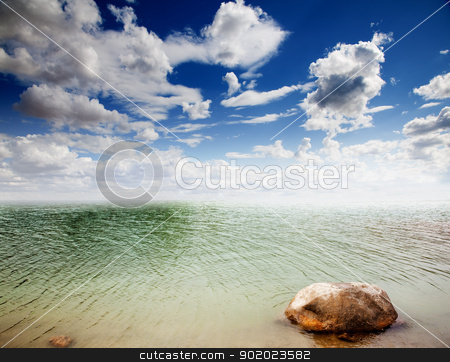seascape  stock photo, Colorful dramatic landscape with water,stone and cloudy sky by carloscastilla